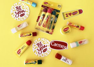 Carmex club products and stickers on a table